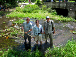 From left are Don Huggins and Debbie Baker in Haiti with Gary Welker, once Huggins' student..